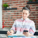 VLV-Discover-how-to-boost-your-business-from-home-Modern-woman-working-at-home