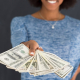 VLV-Income-Definition-Types-and-How-to-increase-them-Woman-with-a-big-income.