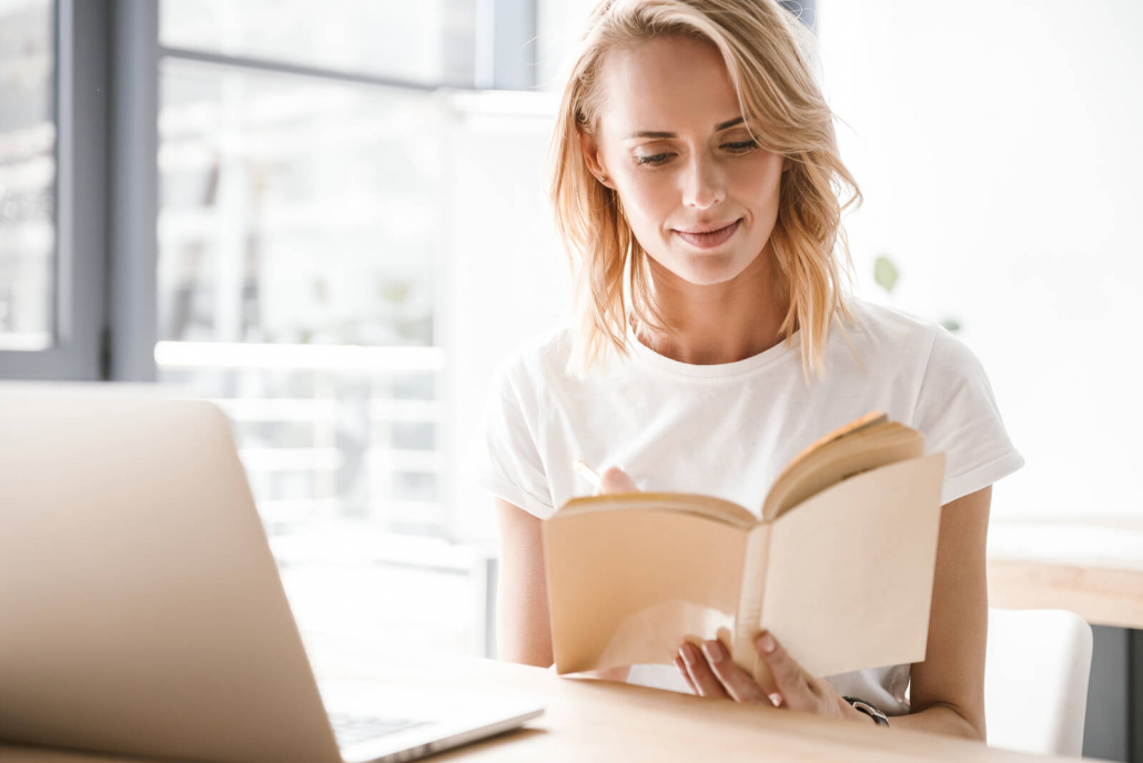 VLV-Read to grow Discover five personal growth books that you should read-Woman reading while work